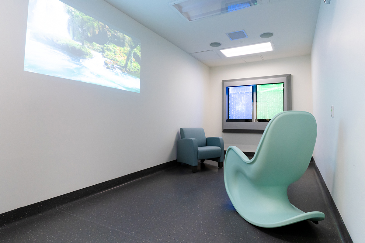 Mental Health - Comfort Room with projected screen and colourful liquid feature